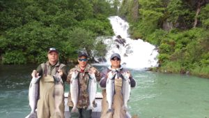 Three men present their catch of six salmon in Alaska.